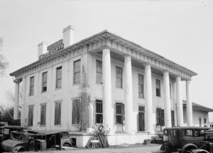 Figure 6: John Drish House, 1837. Back façade view when the house functioned as an auto part shop, with no tower visible and Doric order columns. Captured April 2, 1934. Author: W.N. Manning. Accessed through Wikimedia: http://commons.wikimedia.org/wiki/File:Dr._John_R._Drish_House_Rear_view.jpg.