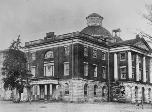 Photograph of the east and south sides of the building, during it's time as an Alabama Central Women's College building. Note the four-story tall dormitory on the left side of the image. Old Alabama State Capitol, Broad Street, Tuscaloosa, Tuscaloosa County, AL From the Library of Congress, 1880 16