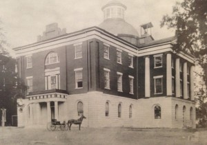 Photograph of the south and eastern sides of the building. The eastern entrance is visible, featuring it's Doric column-supported portico. From Amalia K. Amaki's Tuscaloosa.   13