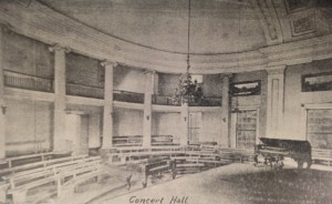 Interior concert hall from the building's time as a Woman's College, once the room of The House of Representatives. Note the ionic pillars, and the similarity to both the Classic Greek amphitheatre and the House of Representatives of the Washington DC Capitol Building. From Amalia K. Amaki's Tuscaloosa.  15
